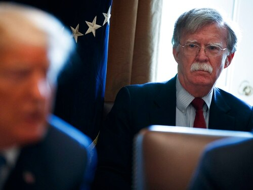 National security adviser John Bolton listens as President Donald Trump speaks during a Cabinet meeting at the White House on April 9, 2018, in Washington. (Evan Vucci/AP)