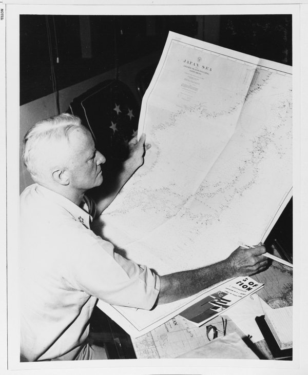 Fleet Adm. Chester Nimitz (CINCPAC-POA), looks at chart of the Japan Sea in his office at Guam in 1945. (U.S. Naval History and Heritage Command)