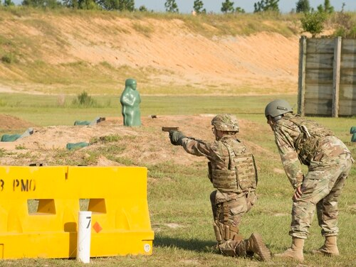 A service member fires the Army's version of the Sig Sauer P320 during a test for U.S. Army Operational Test Command at Fort Bragg, N.C., on Aug. 27, 2017. (Army)