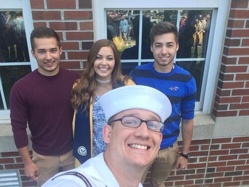 Three siblings - Dominic Herman, 21, back left; Cadi Herman, 18, and Maveric Herman, 21, from East Bethany, N.Y., join the Navy in fall 2017. Their recruiter, Petty Officer 1st Class Shaun Negvesky, front center, said that like many of the other recruits he has signed, Sept. 11 was not a deciding factor for them. Instead, family ties to the military and opportunities for school, career and travel attracted the Hermans to join. (Photo courtesy of Anne Wilson)