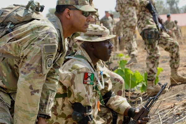 Members of the Security Assistance Training Management Organization team up with Nigerian Army Infantry School soldiers in Nigeria. (Capt. James Sheehan/Army)