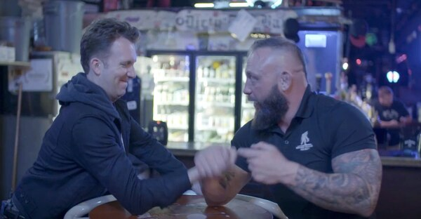 Comedian Jordan Klepper fails to arm wrestle a member from the Valhalla club. (