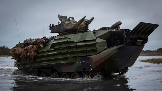 U.S. Marines with 2nd Assault Amphibian Battalion (2d AABN), 2nd Marine Division (2d MARDIV), conduct an amphibious movement aboard an AAV-7A1 Assault Amphibious Vehicle during the unit's Marine Corps Combat Readiness Evaluation (MCCRE) on Camp Lejeune, N.C., March 12. (Lance Cpl. Christian J. Robertson/ Marine Corps)