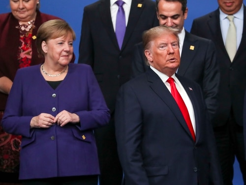 German Chancellor Angela Merkel, left, and U.S. President Donald Trump stand onstage during the annual NATO heads of government summit on Dec. 4, 2019, in Watford, England. (Steve Parsons/Getty Images)