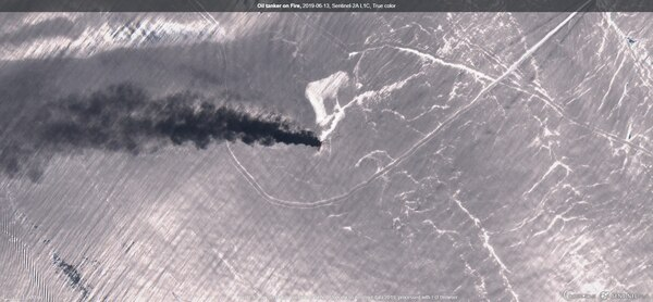 Satellite image of one of the damaged tankers on fire in the Gulf of Oman