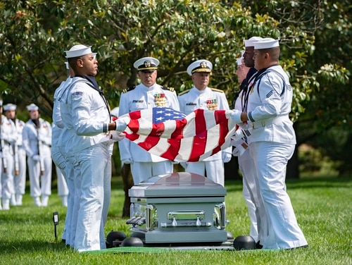 Sailors from the U.S. Navy Ceremonial Guard help conduct military funeral honors with funeral escort for U.S. Navy Cmdr. James. B. Mills in Section 60 of Arlington National Cemetery in Virginia on June 24, 2019. Mills, a Naval Radar Intercept Officer and fellow sailor Capt. James R. Bauder were killed in a plane crash off the coast of Vietnam in 1966. (Elizabeth Fraser/Arlington National Cemetery)