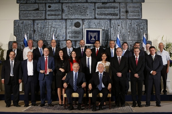 Middle row, second from the left is Minister of Social Affairs Haim Katz, posing with other members of the 34th government of Israel for a group photo at the presidential compound in Jerusalem on May 19, 2015. (Gali Tibbon/AFP via Getty Images)