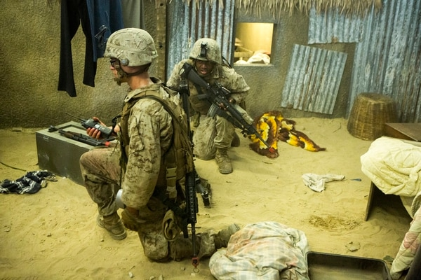 Marines with Bravo Company, 2nd Combat Engineer Battalion, communicate to the rest of their platoon that they have discovered a large weapons cache during the Infantry Immersion Trainer aboard Camp Lejeune, N.C., June 17, 2015. Marines were able to practice tactics, communication within the unit and combat readiness in a realistic training scenario, which better prepared them for a deployed environment. (U.S. Marine Corps photo by Lance Cpl. Aaron K. Fiala/released)