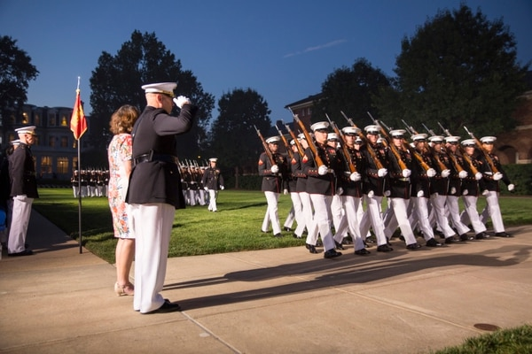 Gen. John M. Paxton, Jr., outgoing Assistant Commandant of the Marine Corps, with his wife Debbie during pass and review on the parade field at the end of his retirement ceremony at the Marine Barracks Washington. (Alan Lessig/Staff)