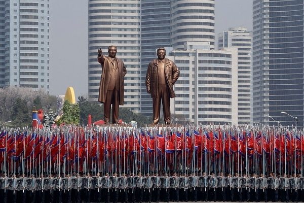 University students carry North Korean national flags and two bronze statues of the late leaders Kim Il Sung, left, and Kim Jong Il during a military parade in Pyongyang, North Korea, on April 15, 2017. (Wong Maye-E/AP)