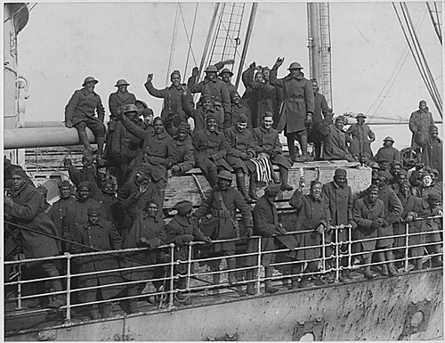 Soldiers of the New York Army National Guard's 369th Infantry Regiment arrive back in New York harbor on Feb. 12, 1919, after serving in France during World War I. The 369th was an African-American unit in a segregated Army which had served under French Army command but earned so many awards for heroism that they became known as the Harlem Hellfighters. (National Archives)
