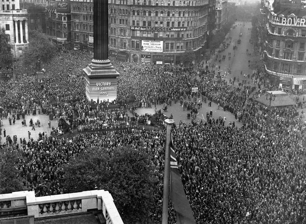 May 1945: V-E Day, held to commemorate the official end of Britain's involvement in World War II, is celebrated by crowds at Trafalgar Square in London on May 8, 1945. (Fred Morley/Fox Photos/Getty Images)