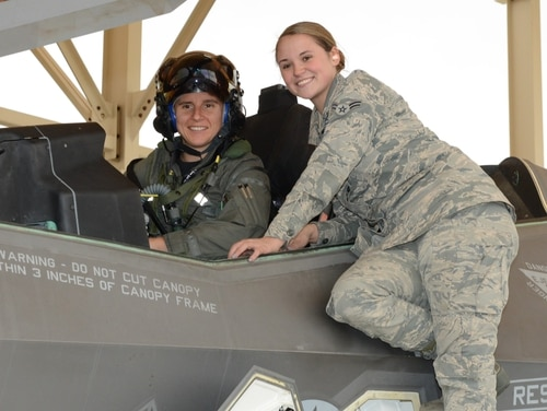 Maj. Rachael Winiecki, the first female test pilot of the F-35, and Airman 1st Class Heather Rice, a crew chief with the 412th Aircraft Maintenance Squadron, are shown immediately after Winiecki landed after her first test mission flight in the advanced fighter. (Kenji Thuloweit/Air Force)