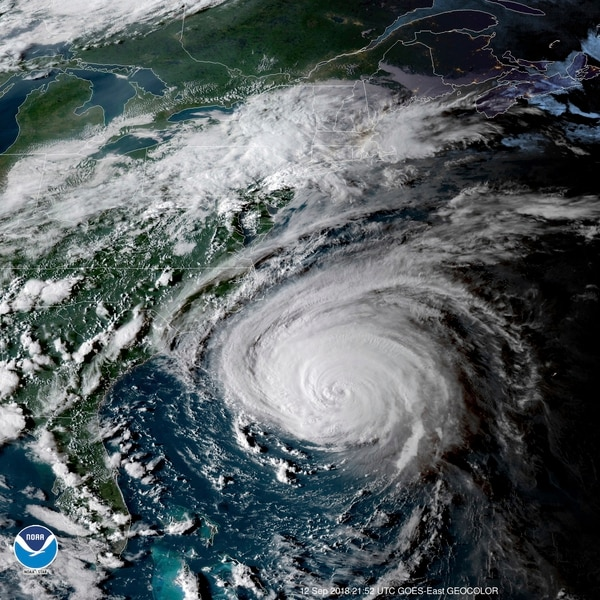 This enhanced satellite image made available by NOAA shows Hurricane Florence off the eastern coast of the United States at 5:52 p.m. EDT on Wednesday. (NOAA via AP)