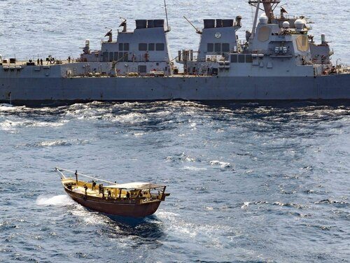 The guided-missile destroyer Winston S. Churchill, in accordance with international law, boarded a stateless dhow off the coast of Somalia and interdicted an illicit shipment of weapons and weapon components, Feb. 12. (U.S. Navy photo by Mass Communication Specialist 3rd Class Louis Thompson Staats IV)