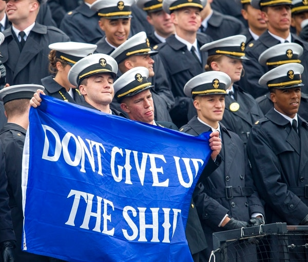 Navy Midshipmen hold a sign on Saturday in Colorado Springs, Colo. (Dougal Brownlie,/The Gazette via AP)