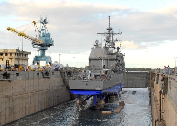 BAE Systems was assigned the use of Pearl Harbor Naval Shipyard's Dry Dock 4, seen here in 2009 undocking the guided-missile cruiser Port Royal. (Liane Nakahara/U.S. Navy)