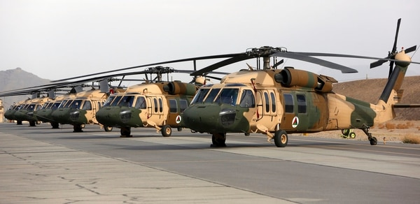 In this Monday, March 19, 2018, photo, UH-60 Black Hawk helicopters are parked at Kandahar Air Field, Afghanistan. (Rahmat Gul/AP)