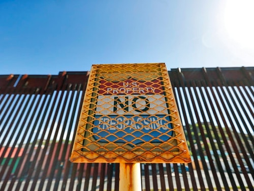 The international border cuts through Nogales, Sonora, Mexico, rear, and Nogales, Ariz., as seen April 9, 2018, from Nogales, Ariz. (Matt York/AP)