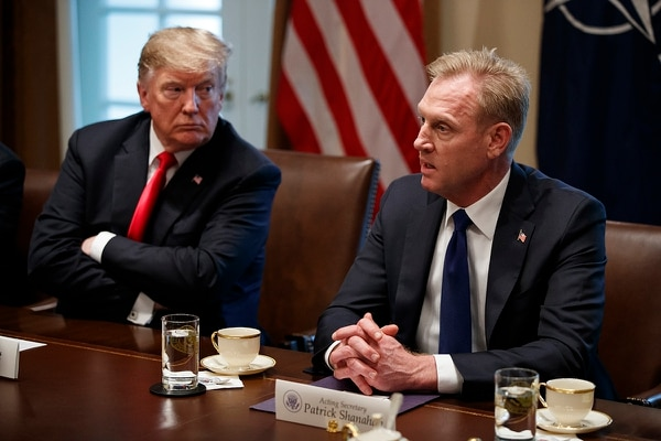 President Donald Trump listens as acting Secretary of Defense Patrick Shanahan speaks during an expanded bilateral meeting with NATO Secretary-General Jens Stoltenberg in the Cabinet Room of the White House, Tuesday, April 2, 2019, in Washington. (Evan Vucci/AP)