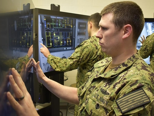Machinist's Mate (Auxiliary) 2nd Class Alex Dorr gets hands-on training with a simulated diesel auxiliary system at Naval Submarine School. (Mass Communication Specialist 3rd Class Tristan B. Lotz/Navy)