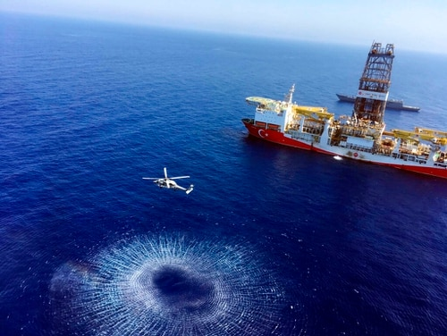 On July 9, a helicopter flies near Turkey's drilling ship, Fatih, in the eastern Mediterranean Sea. (Turkish Defence Ministry via AP)