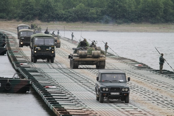 Romanian forces constructed a float-bridge in the middle of the night on July 16 for a river-crossing exercise during which U.S. Stryker vehicles from the 2nd Cavalry drove across. It was part of the U.S.-led Saber Guardian exercise, the largest military exercise in the region this year. (Jen Judson/Staff)