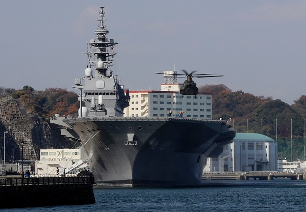 In this Dec. 6, 2016, file photo, a helicopter of Japan Self-Defense Forces prepares to land on the flight deck of the helicopter destroyer Izumo of Japan's Maritime Self-Defense Force following the visit by U.S. Secretary of Defense Ash Carter in Yokosuka, south of Tokyo. (Eugene Hoshiko/AP)