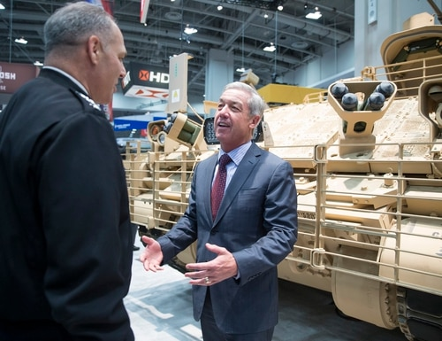 Jerry DeMuro, CEO of BAE Systems Inc., speaks with Gen. Gustave Perna, commander of US Army Materiel Command during the AUSA annual meeting in Washington, D.C. on Tuesday, Oct. 10, 2017. (Mike Morones/Defense News)