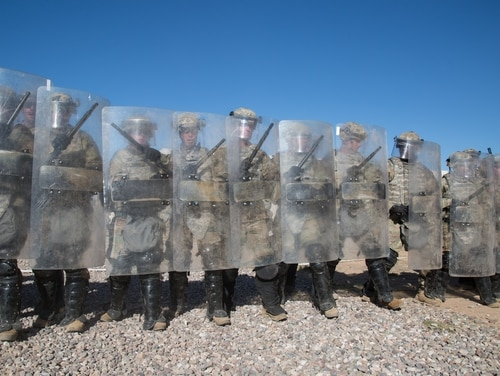 U.S. soldiers assigned to 65th Military Police Company (ABN), 503rd Military Police Battalion, conduct non-lethal riot control training at Davis-Monthan Air Force Base, Arizona, on Nov. 26, 2018. Lawmakers passed a budget resolution on Thursday to postpone for two weeks the deadline for a full-year budget for the Department of Homeland Security and other agencies. (Spc. Hosannah Vickery/Army)