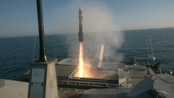 The Freedom-class littoral combat ship Milwaukee fires an AGM-114L Longbow Hellfire missile during a live-fire missile exercise off the coast of Virginia on May 11. (Navy)