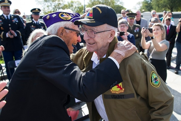 World War II veterans Joseph Caserta, left, and Clarence Smoyer, 96, embrace before a ceremony to present the Bronze Star to Smoyer at the World War II Memorial, Wednesday, Sept. 18, 2019, in Washington. (Alex Brandon/AP)