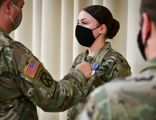 An Army corporal receives a medal during an award ceremony at Caserma Ederle, U.S. Army Garrison Italy in Vicenza, Sept. 18, 2020. (Dario Cortese/Army)