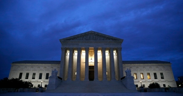 The Supreme Court building is seen at dawn. The Trump administration is asking the court to take up three cases on the issue of transgender people serving in the military. (Patrick Semansky/AP)