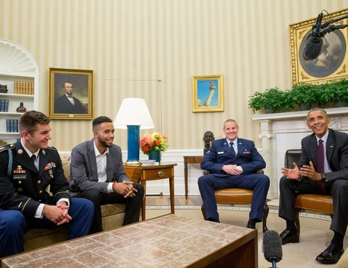 CORRECTS TO PARIS-BOUND TRAIN - President Barack Obama meets with, from left, Oregon National Guardsman Alek Skarlatos, Anthony Sadler, and Air Force Airman 1st Class Spencer Stone in the Oval Office of the White House in Washington, Thursday, Sept. 17, 2015, to honor them for heroically subduing a gunman on a Paris-bound passenger train last month. (AP Photo/Andrew Harnik)