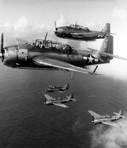 Avengers of VT-6 flying from the USS Intrepid in 1944. The USS Intrepid was one of the aircraft carriers involved in Operation Hailstone, an Allied aerial assault on Japanese-held island positions in the Pacific Theater. (Courtesy of Project Recover/United States Navy Museum of Naval Aviation)