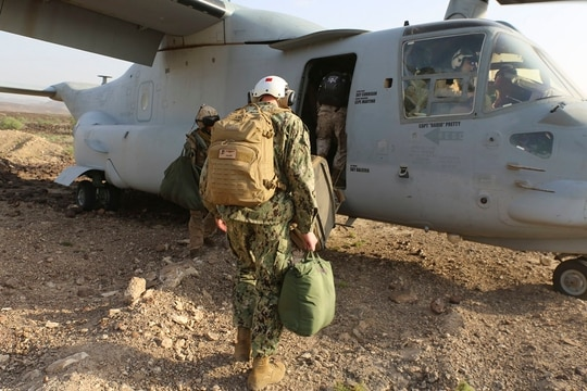 Marines and Sailors assigned to Naval Amphibious Force, Task Force 51/5th Marine Expeditionary Brigade board an MV-22 Osprey tilt rotor aircraft during Theater Amphibious Combat Rehearsal (TACR 18). (Staff Sgt. David L. Proffitt/Marine Corps)