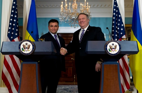 Secretary of State Mike Pompeo shake hands with Ukrainian Foreign Minister Pavlo Klimkin after speaking to the media at the Department of State Friday, Nov. 16, 2018, in Washington. (AP Photo/Jose Luis Magana)
