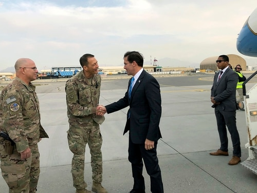U.S. Defense Secretary Mark Esper, center, is greeted by U.S. military personnel upon arriving in Kabul, Afghanistan, Sunday, Oct. 20, 2019. (Lolita C. Balbor/AP)
