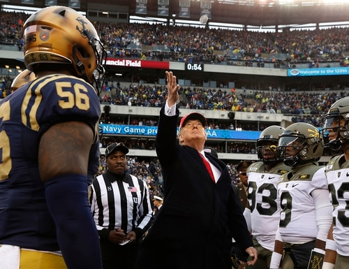 President Donald Trump throws the coin before the start of the Army-Navy college football game in Philadelphia on Dec. 14, 2019. (Jacquelyn Martin/AP)