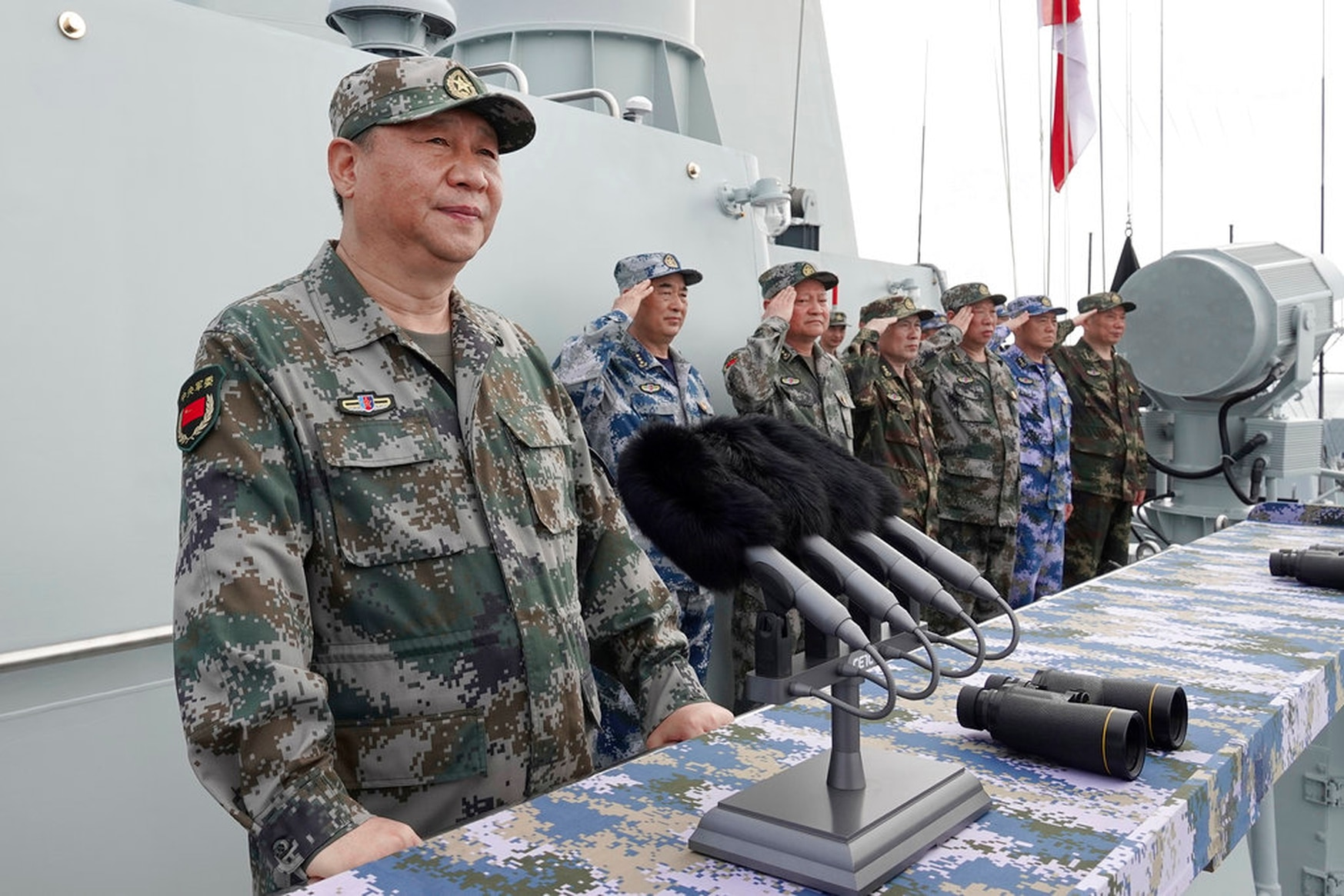 Chinese President Xi Jinping speaks after reviewing the Chinese People's Liberation Army Navy fleet in the South China Sea on April 12, 2018. Xi is calling on the PLAN to better prepare for combat amid tensions over Taiwan and the South China Sea. (Li Gang/Xinhua via AP)