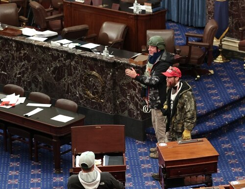Retired Air Force lieutenant colonel Larry Rendall Brock Jr. was photographed on the Senate floor clad in tactical gear and holding flex cuffs. (Photo by Win McNamee/Getty Images)