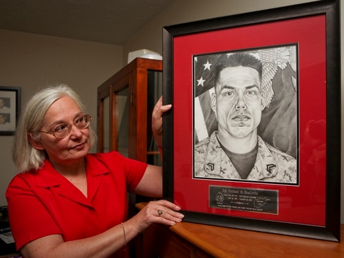 Donna Ouellette, mother of fallen Marine Cpl. Michael W. Ouellette, has a room in her home that honors the memory of her son with plaques, shadow boxes, photographs and a drawing that depicts the fallen squad leader who served with Company L, 3rd Battalion, 8th Marine Regiment. (Sgt. Michael S. Cifuentes/Marine Corps)