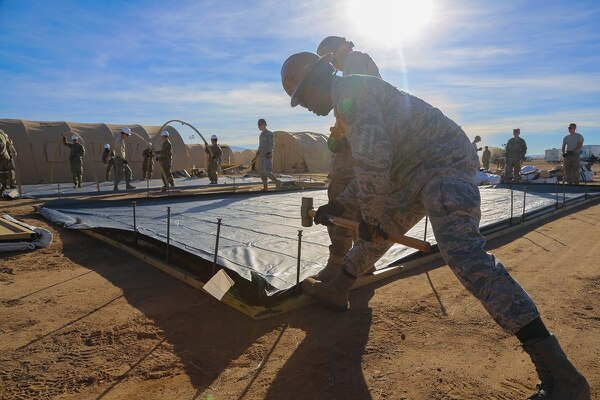 A U.S. airmen of 355 Civil Engineer Squadron secure the frame of a tent at Davis-Monthan Air Force Base, Ariz., Nov. 4, 2018. Various military branches are deployed as support to local Department of Homeland Security and U.S. Customs and Border Protection agents in support of Operation Faithful Patriot. (Spc. Keion Jackson/Army)