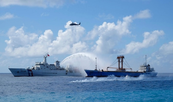 A Taiwan Coast Guard ship, left, and cargo ship take part in a search-and-rescue exercise off of Taiping island in the South China Sea as part of Taiwan's efforts to cement its claim to a key island in the strategically vital waterway in 2016. Taiwan's coast guard said annual live-fire exercises conducted at Taiping island in the Spratly island group were routine and didn't endanger shipping. Neighboring countries were informed in advance of the exercises carried out on last week, the coast guard said. (Johnson Lai/AP)