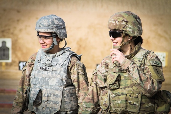 Two female U.S. soldiers walk back after checking their targets at a qualification range on Kandahar Airfield, Afghanistan, March 9, 2014. Women continue to play vital roles in all branches of the armed services, including in the combat arms which opened to women in 2013. (U.S. Army photo by Cpl. Clay Beyersdorfer/Released)