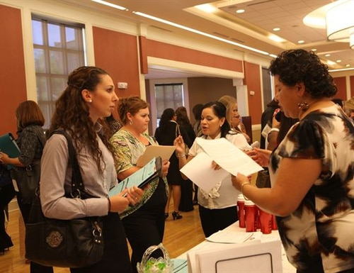 Army and Air Force spouses can now apply for reimbursement of up to $500 in fees paid for professional licensing in order to work in the state where they move with their service member. Navy and Marine Corps officials are expected to have similar policies for their spouses. Here, military spouses attend a job fair at Camp Lejeune, N.C. (Lance Cpl. Jackeline M. Perez Rivera/Marine Corps)