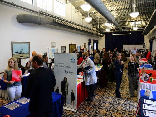 Military spouses talk local employers during a career fair at Dover Air Force Base in Delaware in March 2018. New legislation introduced in Congress this week would simplify the licensing and credentialing processes for spouses after military moves. (Staff Sgt. Aaron J. Jenne/Air Force)