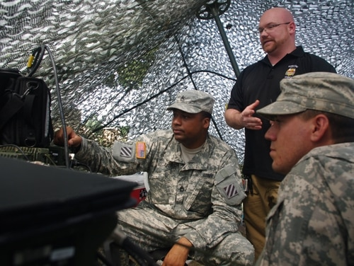 Sgt. 1st Class Willie Carter, the 3rd Infantry Division Electronic Warfare Noncommissioned Officer (left), Mr. Phillip Crandell, the 3rd Infantry Division EW Trainer (center), Sgt. Jacob Stauber, the EW NCO of 2nd Battalion, 69th Armor Regiment, 3rd Armored Brigade Combat Team, 3rd ID, observe the spectrum of frequencies being used for communications during Marne Focus, 25 June. The group of EW personnel are preparing to test the reaction times of units participating in the exercise by jamming their communications. (U.S. Army photo by Staff Sgt. Aaron Knowles, 3rd ABCT, 3rd ID, PAO).
