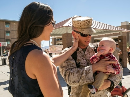 Staff Sgt. Mark Gray, weapons platoon sergeant, Animal Company, 1st Battalion, 7th Marine Regiment, meets his son, Mark Gray Jr., for the first time during the unit's homecoming at the 1/7 barracks courtyard aboard the Marine Corps Air Ground Combat Center, Twentynine Palms, Calif., Oct. 22, 2017. (Pfc. Rachel K. Young/Marine Corps)